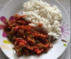 Ngombe na loso (Afrikanisches Rindfleisch mit Reis)