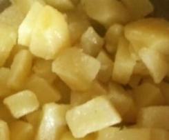Kartoffelwürfel mit Knoblauchbutter