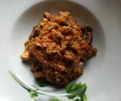 Tomatenrisotto mit Champignons und Geflügelfleisch