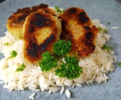 Frischkäsetaler auf Reis