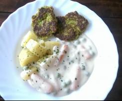 Käse-Gemüseburger mit Kartoffeln und Erbsen-Möhren-Soße