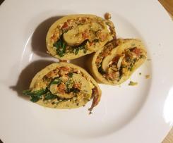 Pfannkuchenruolade mit Rucola vegetarisch