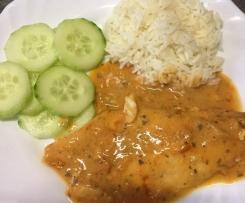 Pangasiusfilet in Weißwein-Tomaten-Sahnesauce mit Reis